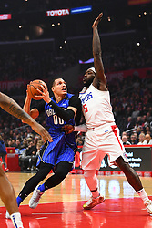 January 6, 2019 - Los Angeles, CA, U.S. - LOS ANGELES, CA - JANUARY 06: Orlando Magic Forward Aaron Gordon (00) drives on Los Angeles Clippers Center Montrezl Harrell (5) during a NBA game between the Orlando Magic and the Los Angeles Clippers on January 6, 2019 at STAPLES Center in Los Angeles, CA. (Photo by Brian Rothmuller/Icon Sportswire) (Credit Image: © Brian Rothmuller/Icon SMI via ZUMA Press)