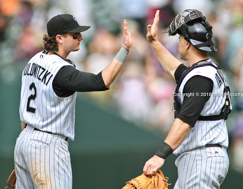 SHOT 8/4/10 4:04:00 PM - The Colorado Rockies Troy Tulowitzki high fives teammate Chris Iannetta after a 6-1 victory over the San Francisco Giants during their regular season game at Coors Field in downtown Denver, Co. (Photo by Marc Piscotty / © 2010)