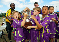 10 April 2016. Hammond, Louisiana.<br /> South Tangi Youth Soccer Association (STYSA), Chappapeela Sports Complex, 30th Annual Strawberry Cup,  <br /> New Orleans Jesters Youth Academy U10 team Purple celebrate victory over CD Motagua in the Cup Final.<br /> Jesters won 5-4 to become Strawberry Cup Champions for the 2nd year running. <br /> Photo©; Charlie Varley/varleypix.com
