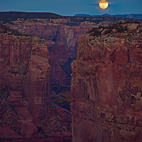 Moon rise over red sandstone of Canyon de Chelly Arizona.