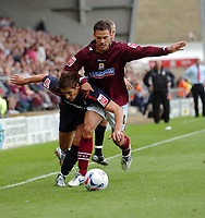 Photo: Kevin Poolman.<br />Northampton Town v Nottingham Forest. Coca Cola League 1. 12/08/2006. Forest's Nicky Southall is pushed off the ball by Northampton's Pedj Bojic