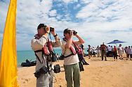 Two field staff members comparing binoculars at Montgomery Reef, Kimberley Coast, Australia
