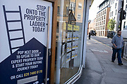 Estate agents sign on 11th August 2021 in London, United Kingdom. The sign asks people and in particular first time buyers to step onto the property ladder.
