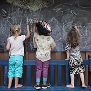 Linköping, Sweden, August 19, 2012. Children play in the outdoor space at Stolplyckan, the second biggest collective in Sweden with 184 apartments. <br /> <br /> Linköping, Svezia, Agosto 2012. Bambini giocano negli spazi comuni del collettivo Stolplyckan, il secondo più grande collettivo abitativo della Svezia, con un totale di 184 appartamenti.