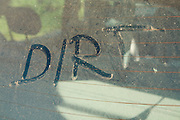 The word 'DIRT' written on car rear windscreen following Saharan sand deposited in England by strong south easterly winds