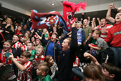 Lincoln City fans celebrate as they watch the Emirates FA Cup, Quarter Final draw in the Travis Perkins bar at Sincil Bank, Lincoln.