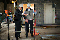 NEW YORK, NY – NOVEMBER 8, 2013:  CEO of Marriott Hotels, Arne Sorenson, left, at the at the Metropolitan Life Insurance Company Tower on Madison Square Park in Manhattan where a new brand of Marriott Hotels, Edition Hotel New York, is being installed and set to open in 2015. <br /> <br /> Photo © Robert Caplin