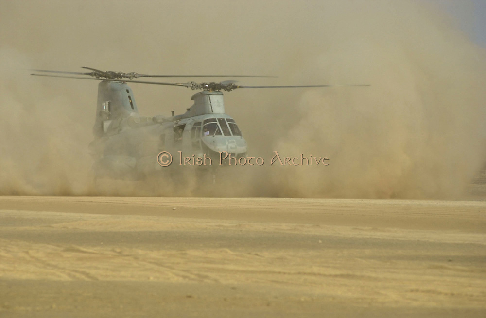 """Camp Rhino, Afghanistan (Dec. 2, 2001) -- A United States Marine Corps. CH-46 """"Sea Knight"""" helicopter lands on the desert landing strip code named """"Rhino."""" Rhino is a forward-base of operations strategically located inside Afghanistan. U.S. Navy Photo"""