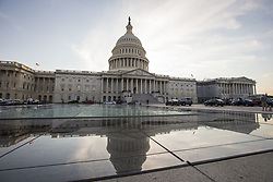July 24, 2017 - Washington, District Of Columbia, USA - The United States Capitol Building is reflected in the glass roof of the Capitol Visitors Center on Capitol Hill at sunset. (Credit Image: © Alex Edelman via ZUMA Wire)