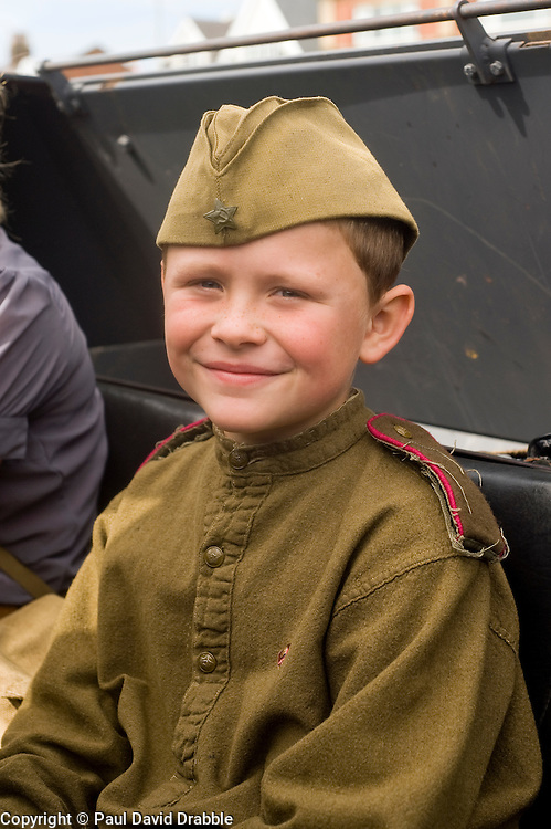 A young reenactor playing a member of the Soviet 13th Guards is held as a POW during a Northern World War Two Association Battle reenactment at the Lytham St Annes Battle of Britain Celebration 1940s War Weekend 21 Aug 2010 <br /> Images © Paul David Drabble