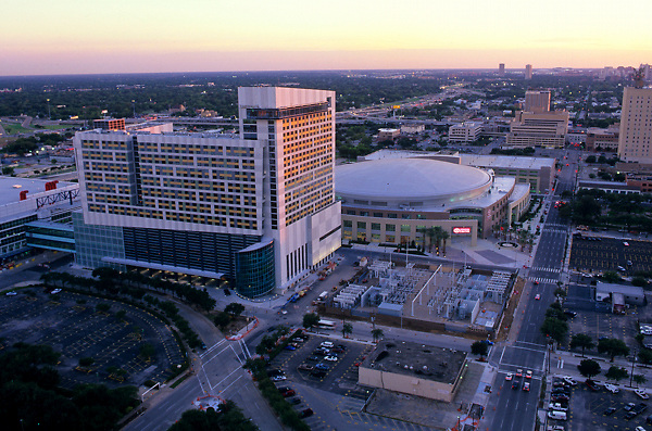 Aerial view the Hilton Americas - Houston and the Toyota Center in downtown Houston, Texas at dusk.