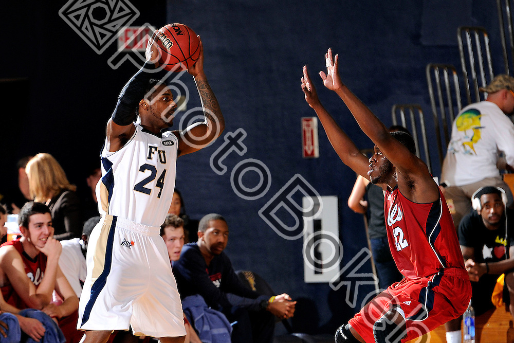 2013 February 07 - FIU guard Malik Smith (24) and FAU guard Greg Gantt (22). .Florida International University defeated Florida Atlantic University, 84-65, at the US Century Bank Arena, Miami, Florida. .(Photo by: www.photobokeh.com / Alex J. Hernandez) This image is copyright PhotoBokeh.com and may not be reproduced or retransmitted without express written consent of PhotoBokeh.com. ©2013 PhotoBokeh.com - All Rights Reserved