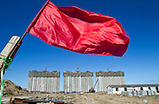 A red flag waved in the wind at the construction site of a developments of apartment buildings in the suburbs of Tianjin.