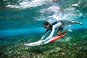 Graeme Fenton, duck diving at Tiger Stripes, Maldives