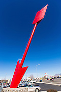 A giant red arrow sculpture pierces a blue sky at the Indian Plaza shopping center December 7, 2015 in Albuquerque, New Mexico. The arrow was constructed in 1961 and is 20-feet tall.