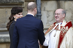 The Dean of Windsor David Conner greets the Duke and Duchess of Cambridge as they arrive for the Easter Mattins Service at St George's Chapel, Windsor Castle, Windsor.