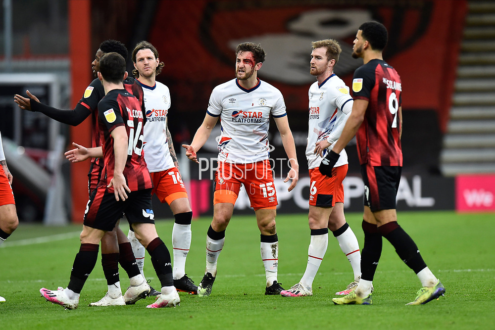 Tom Lockyer (15) of Luton Town has blood coming from an injury on his head after a challenge by Jefferson Lerma (8) of AFC Bournemouth during the EFL Sky Bet Championship match between Bournemouth and Luton Town at the Vitality Stadium, Bournemouth, England on 16 January 2021.