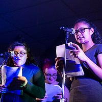 """Leah Dona, left, and Amayia Gonzales perform in a readers theater version of """"The Boor"""" by  Anton Chekhov at Thoreau High School during their open mic night, Wednesday, Dec. 12 in Thoreau."""