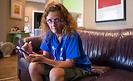 Sara Winsted at her home in Edmond, an upscale Oklahoma City suburb, a, living with frequent earthquakes. She follows earthquake updates on her iphone with an earthquake app.