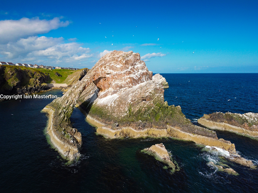 Aerial view from drone of Bow Fiddle Rock at Portnockie on Moray Firth in Moray, Scotland, UK