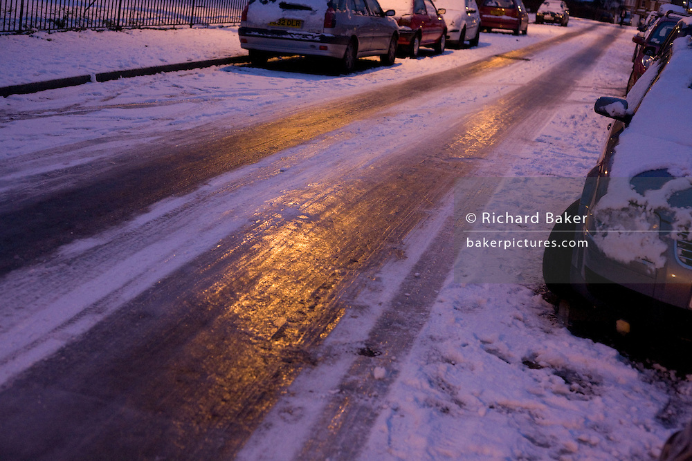 Treacherous sheet ice glistens on a South London street during the early 2010 snows that gripped the UK.
