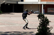 DURBAN - 10 October 2016 - An officer from the security company MI7 shoots plastic balls at students who had started throwing stones during the protests for fees at the University of KwaZulu-Natal's Westville campus to be abolished. South Africa's tertiary institutions have been gripped by ongoing protests against university fees and a host of other complaints. Allied Picture Press/APP
