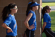 Middletown, New York - Middletown players watch their team from the dugout during a varsity girls' softball game on May 19, 2014.