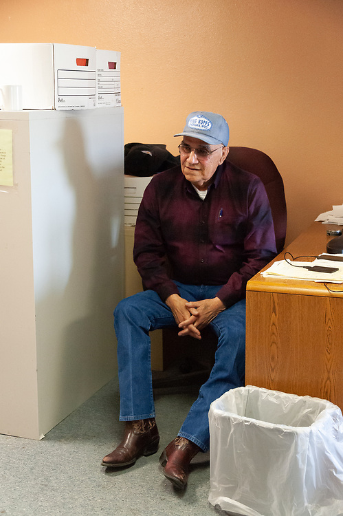 Calvin Herrera, Clayvin's father and cabinet head of the Crow Tribe Education Department, in his office.