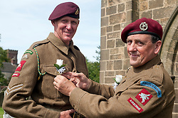 1940's Wedding Lytham Bridegroom Andy Hacking has his button hole straightened by best man Dave Dennis outside Lytham Church.Saturday 19 August 2011  Image © Paul David Drabble