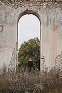 A Swiss visitor explores the grounds of the abandoned Real School in Shushi, in the disputed region of Nagorno-Karabakh. <br /> <br /> (September 23, 2016)