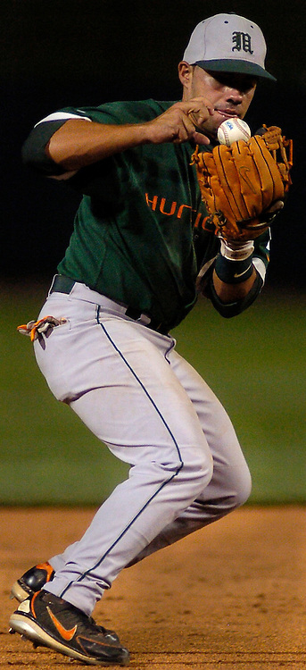 Miami's Roger Tomas can't get the handle on the ball..(Chris Machian/Prairie Pixel Group)