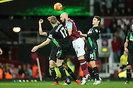 James Collins of West Ham United heads the ball for goal over Ryan Shawcross, the Stoke City captain. Barclays Premier league match, West Ham Utd v Stoke city at the Boleyn Ground, Upton Park  in London on Saturday 12th December 2015.<br /> pic by John Patrick Fletcher, Andrew Orchard sports photography.