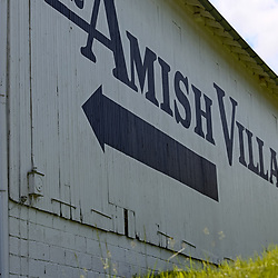 Strasburg, PA, USA - May 23, 2018: A large directional sign painted on a barn at the Amish Village in Lancaster County, a popular tourist attraction.