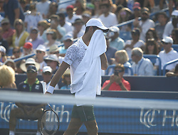 August 19, 2018 - Mason, Ohio - Novak Djokovic wipes his forehead as he takes on Roger Federer in the finals of the Western and Southern Open at the Lindner Family Tennis Center in Mason, Ohio on Sunday, August 19, 2018.  Djokovic won the match 6-4, 6-4.  The Cincinnati Masters is an annual outdoor hardcourt tennis event held in Mason near Cincinnati, Ohio. The event started on September 18, 1899 and is the oldest tennis tournament in the United States played in its original city. (Credit Image: © Leigh Taylor via ZUMA Wire)