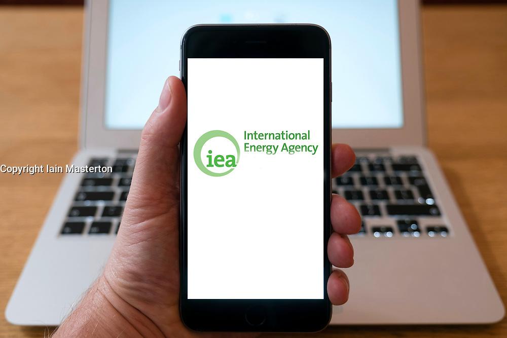 International Energy Agency, IEA, logo on  website on smart phone screen.