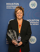 Houston Astros Senior Vice President for Community Relations Meg Vaillancourt poses with a Hall of Fame trophy following the Houston ISD Partnership Appreciation breakfast at Kingdom Builders, October 25, 2013.