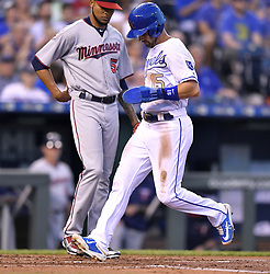 September 8, 2017 - Kansas City, MO, USA - The Kansas City Royals' Whit Merrifield steps on home in front of Minnesota Twins starting pitcher Ervin Santana to score on a sacrifice fly by Melky Cabrera in the first inning at Kauffman Stadium in Kansas City, Mo., on Friday, Sept. 8, 2017. (Credit Image: © John Sleezer/TNS via ZUMA Wire)