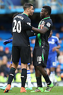 Geoff Cameron of Stoke City pushes Mame Biram Diouf of Stoke City. Barclays Premier league match, Chelsea v Stoke city at Stamford Bridge in London on Saturday 5th March 2016.<br /> pic by John Patrick Fletcher, Andrew Orchard sports photography.