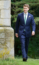 © London News Pictures. 14/09/2013.  Euan Blair in the grounds of the church before the wedding. The wedding of Euan Blair, Son of former British Prime Minister Tony Blair,  to Suzanne Ashman at All Saints Parish Church in Wotton Underwood, Buckinghamshire. The wedding was attended by Former British Prime minister Tony Blair and his wife Cherie Blair. Photo credit: Ben Cawthra/LNP