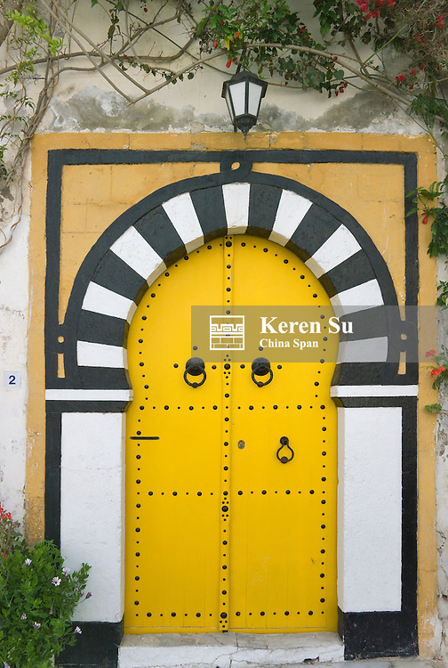 Yellow painted door in traditional house, Sidi Bou Said, Tunis, Tunisia