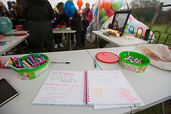 © Licensed to London News Pictures. 16/01/2017. York UK. Picture shows a book of condolence for Katie Rough. Katie Rough's parents Paul Rough & Alison Rough where joined by hundreds of people in Westfield Park in York this afternoon to release balloons on what would have been Katie's 8th birthday. Katie died last week after being found with significant cuts to her neck & chest.  Photo credit: Andrew McCaren/LNP