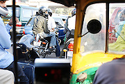India, Delhi, urban traffic as seen from within a Tuk tuk