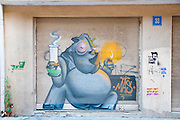 hippo with a water pipe Graffiti wall art in Florentin neighbourhood, Tel Aviv