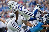 NASHVILLE, TN - OCTOBER 30:   Joe Lefeged #35 of the Indianapolis Colts dives over the pile during a game against the Tennessee Titans at the LP Field on October 30, 2011 in Nashville, Tennessee.  The Titans defeated the Colts 27 to 10.  (Photo by Wesley Hitt/Getty Images) *** Local Caption *** Joe Lefeged Sports photography by Wesley Hitt photography with images from the NFL, NCAA and Arkansas Razorbacks.  Hitt photography in based in Fayetteville, Arkansas where he shoots Commercial Photography, Editorial Photography, Advertising Photography, Stock Photography and People Photography