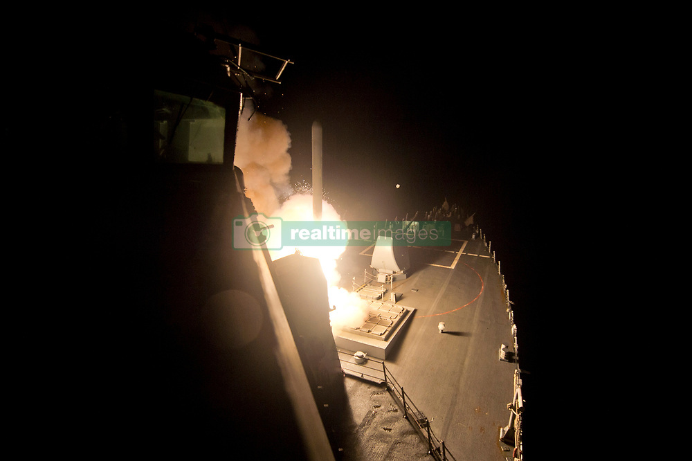 April 6, 2017 -  (File Photo) - The U.S. military launched a military strike with approximately 50 cruise missiles at a Syrian military airfield late on Thursday, in retaliation for their chemical weapon attack on civilians earlier in the week.  PICTURED: Sep 23, 2014 - Red Sea  - The guided-missile destroyer USS Arleigh Burke (DDG 51) launches Tomahawk cruise missiles to conduct strikes against ISIL targets. Arleigh Burke is deployed in the U.S. 5th Fleet area of responsibility supporting maritime security operations and theater security cooperation efforts. The US and five Arab allies have launched the first strikes against Islamic State (IS) militants in Syria. (Credit Image: © Carlos M. Vazquez/U.S. Navy/ZUMAPRESS.com)