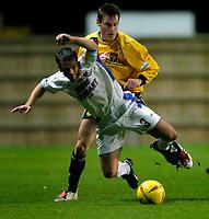 Photo: Richard Lane.<br />Oxford United v Carlisle United. Nationwide Division Three. 13/12/2003.<br />Tom Cowan is sent flying by Dean Whitehead.