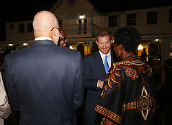 Prince Harry meets guests during a reception hosted by Governor-General of Saint Kitts and Nevis Sir Tapley Seaton at Government House, Basseterre, during the second leg of his Caribbean tour.