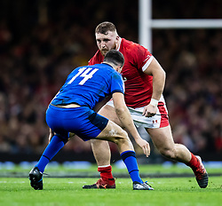 Dillon Lewis of Wales under pressure from Leonardo Sarto of Italy<br /> <br /> Photographer Simon King/Replay Images<br /> <br /> Six Nations Round 1 - Wales v Italy - Saturday 1st February 2020 - Principality Stadium - Cardiff<br /> <br /> World Copyright © Replay Images . All rights reserved. info@replayimages.co.uk - http://replayimages.co.uk