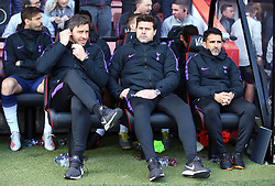 Tottenham Hotspur manager Mauricio Pochettino (centre), first team coach Jesus Perez (right) and Miguel D'Agostino in the dugout during the Premier League match at the Vitality Stadium, Bournemouth.