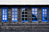 Blue windows on wooden house in Sandavágur, Faroe Islands.